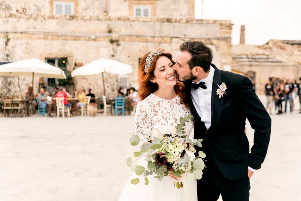 Groom kiss your bride in Marzamemi